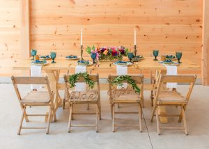 Gorgeous custom harvest table at Events At Hemlock Springs wedding & event venue.