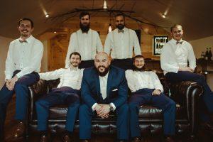 Groom and groomsmen in the man cave
