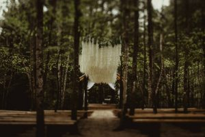 Twilight inspired forest wedding with hanging wisteria at Events At Hemlock Springs.