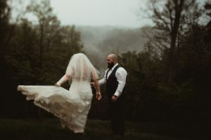 Romantic wedding with Bride and Groom in the fog at Events At Hemlock Springs.