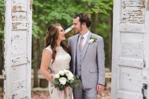 Bride and Groom between antique doors in a Red River Gorge forest wedding at Events At Hemlock Springs.