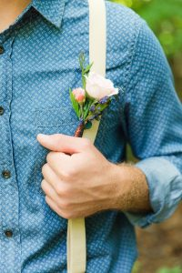 Groom with suspenders and his boutonnières at Events At Hemlock Springs.