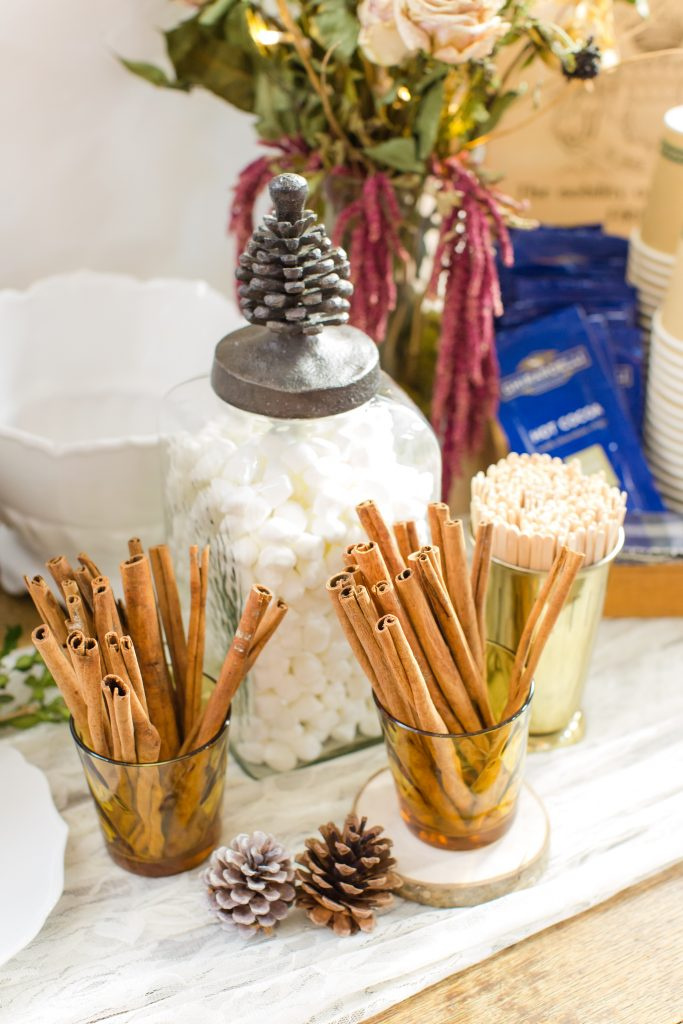 Marshmallows and cinnamon sticks adorn a hot beverage bar at a cozy fall wedding.