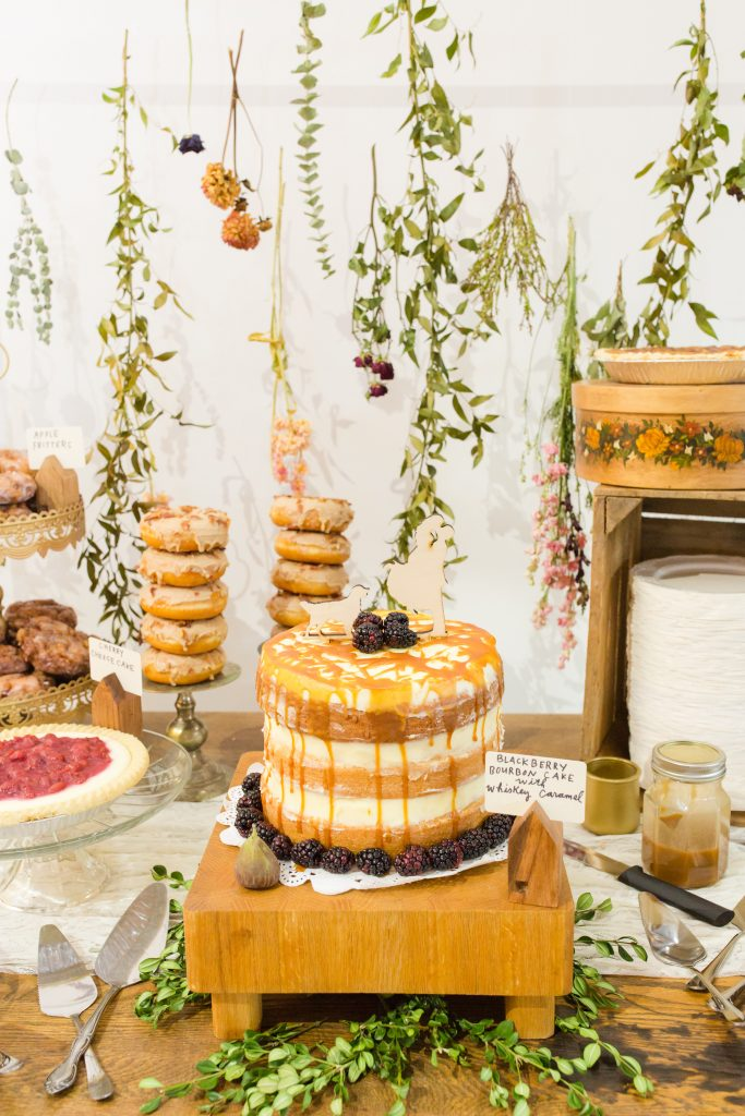 Unique custom wood cake topper adds a personal touch to the dessert display.