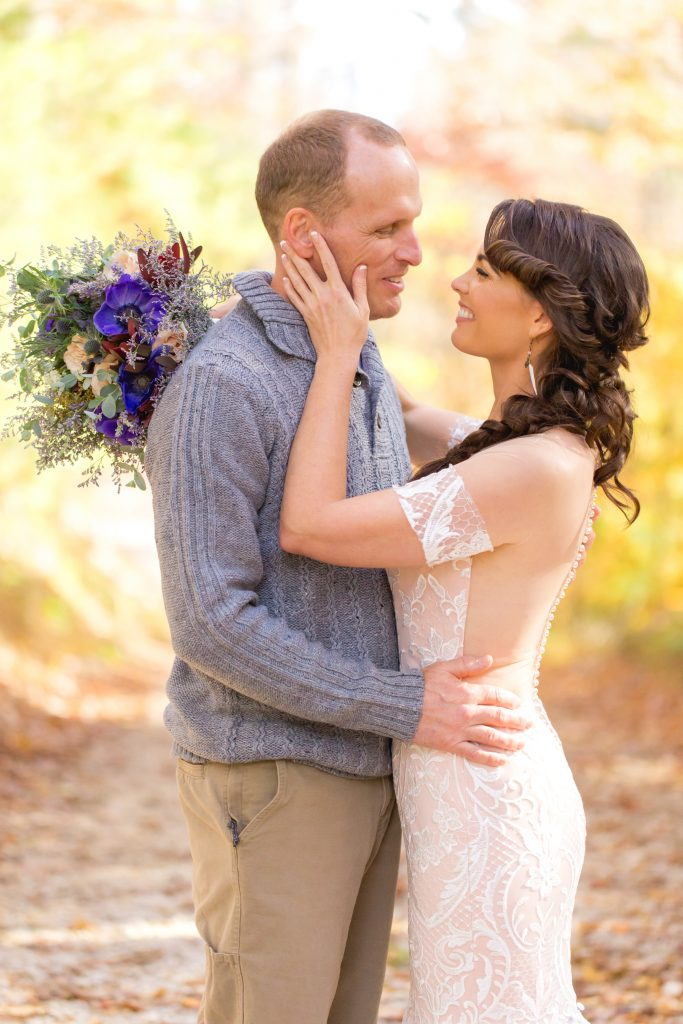 Bride and Groom smiling at each other in their fall Red River Gorge wedding at Hemlock Springs.