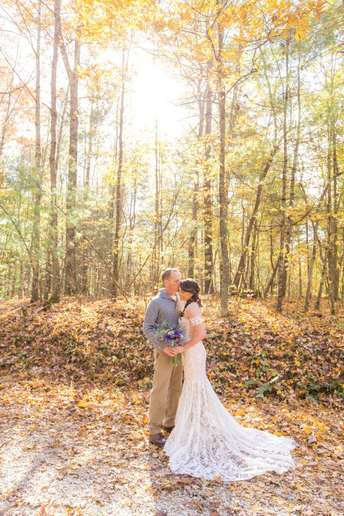 Bride and Groom enjoy a sweet moment in the sun during their fall wedding.
