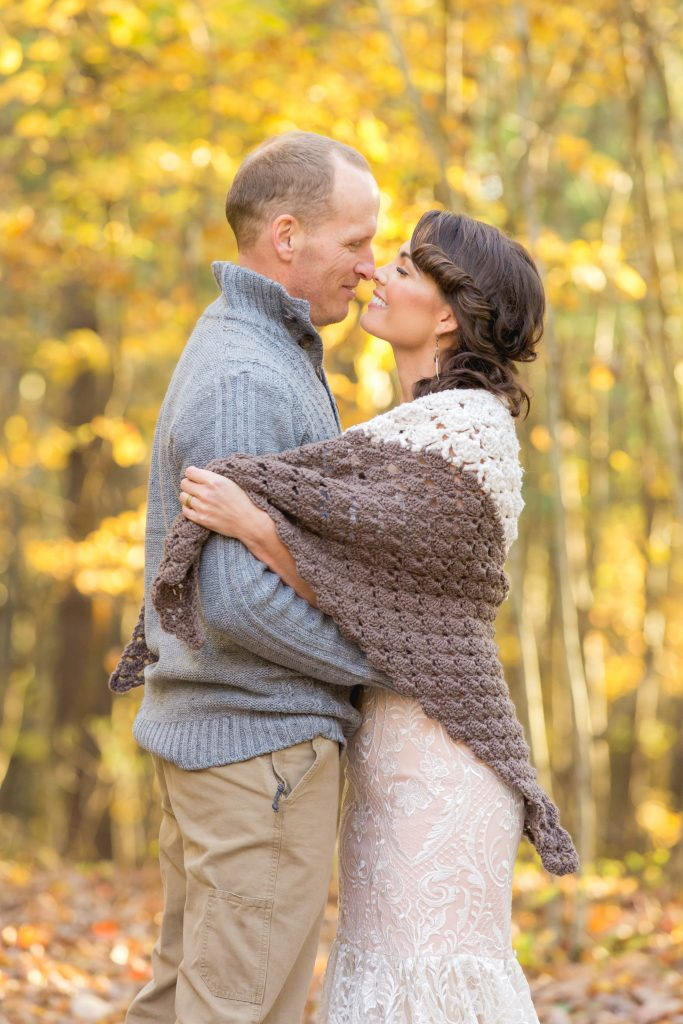 Eskimo kisses with Bride and Groom in their gorgeous fall forest wedding.