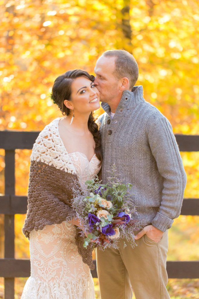 Beautiful fall wedding in the Red River Gorge with Groom kissing his Bride.