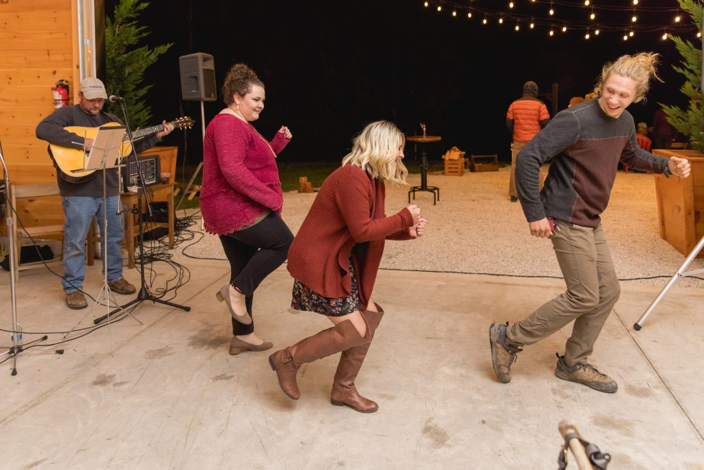 Wedding guests dance the electric slide at a wedding at Hemlock Springs.