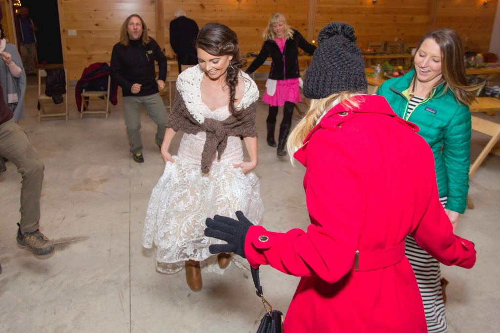 A bride dances with her guests at a cozy fall wedding in the Red River Gorge at Hemlock Springs.