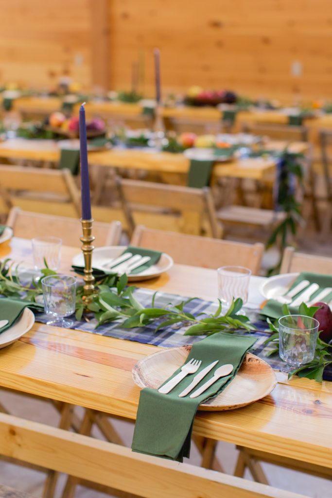 Beautiful fall place settings on wooden harvest tables at a fall wedding at Hemlock Springs.