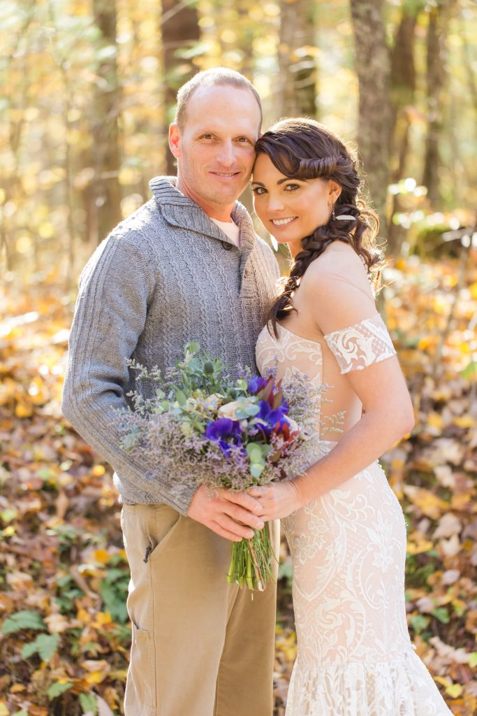 Fall wedding inspiration with Bride and Groom in the woods.