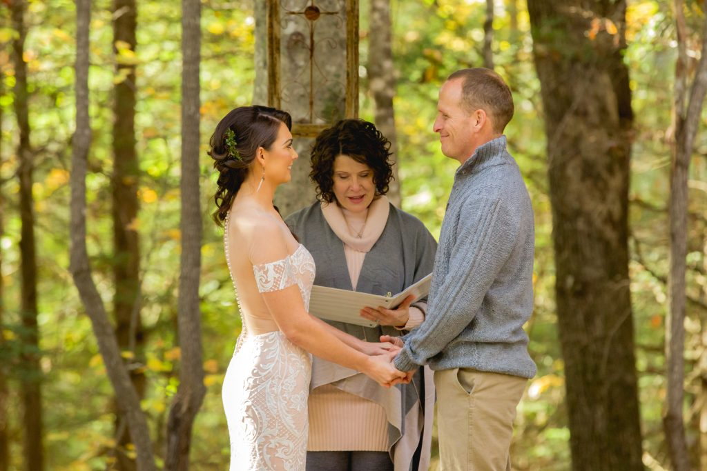 Bride and groom take their vows in a forest wedding at Hemlock Springs in the Red River Gorge.